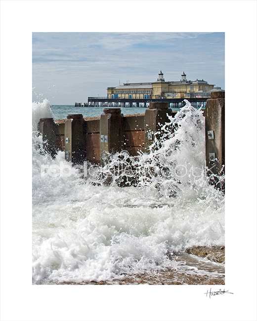 "Photograph of Hastings Pier with crashing wave by Hastings Photographer Jon ""Huldrick' Wilhelm."